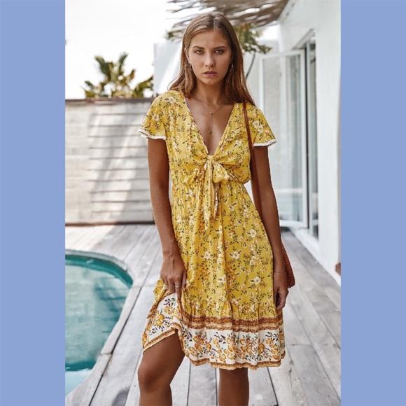 Dresses & Skirts - Yellow V-Neck Floral Print Ruffled Dress
